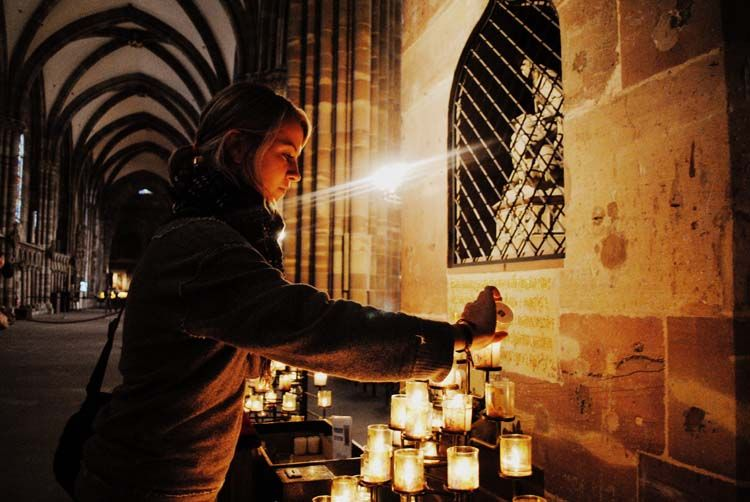 Student lighting a candle