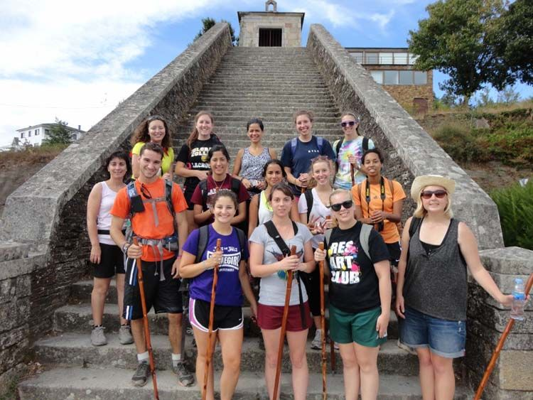 Students in front of a stone staircase