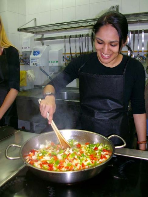 Salamanca student stirring vegetables