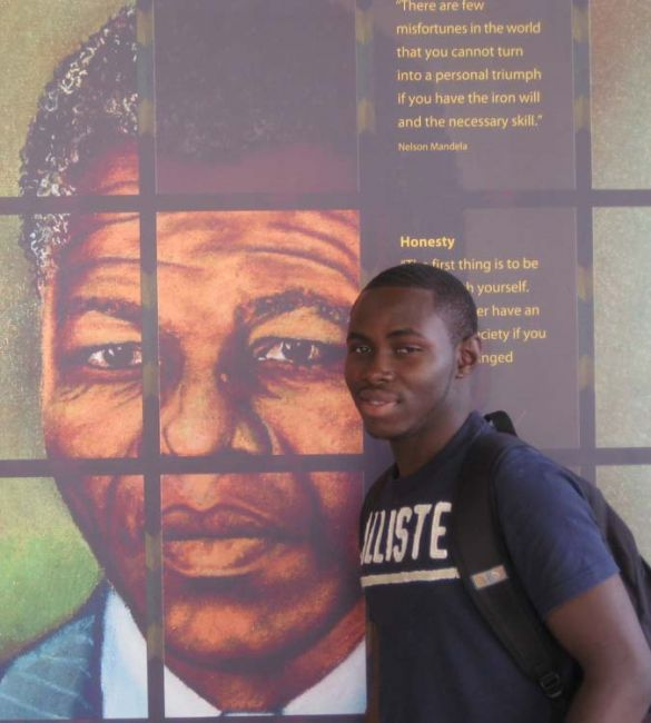 Student by image of Nelson Mandela
