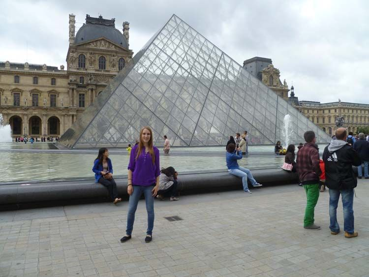 Standing in front of the pyramid by the Louvre