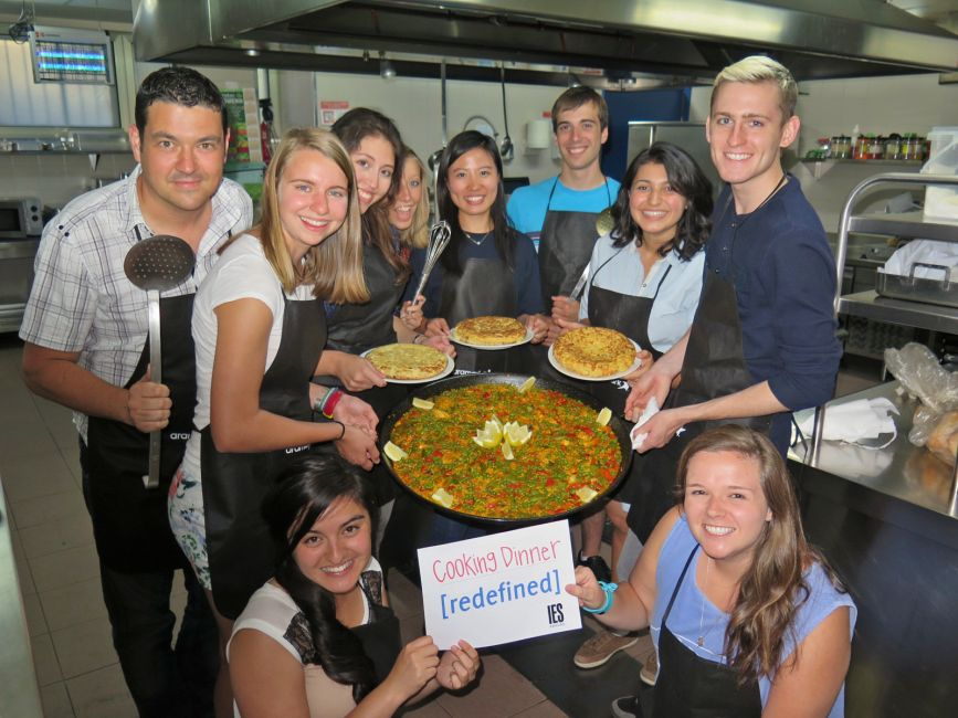 Students cooking paella