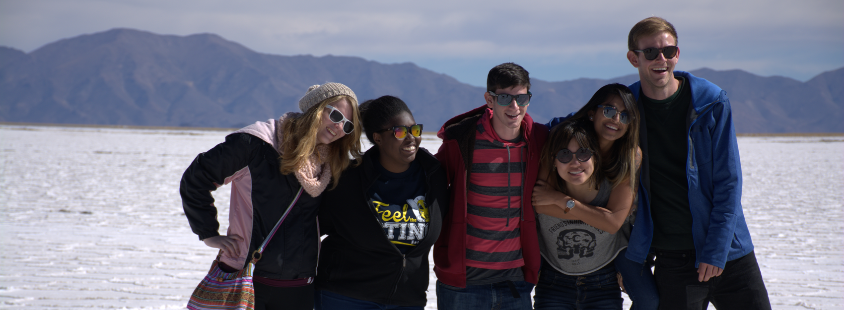 A diverse group of IES Abroad students visiting salt flats