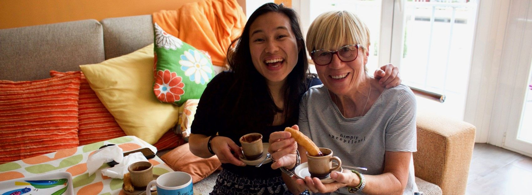 Student in Spain with her host mom in their apartment