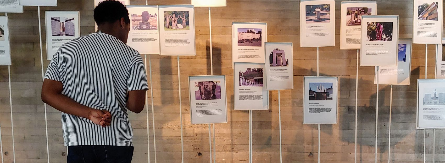 student reading museum display in chile