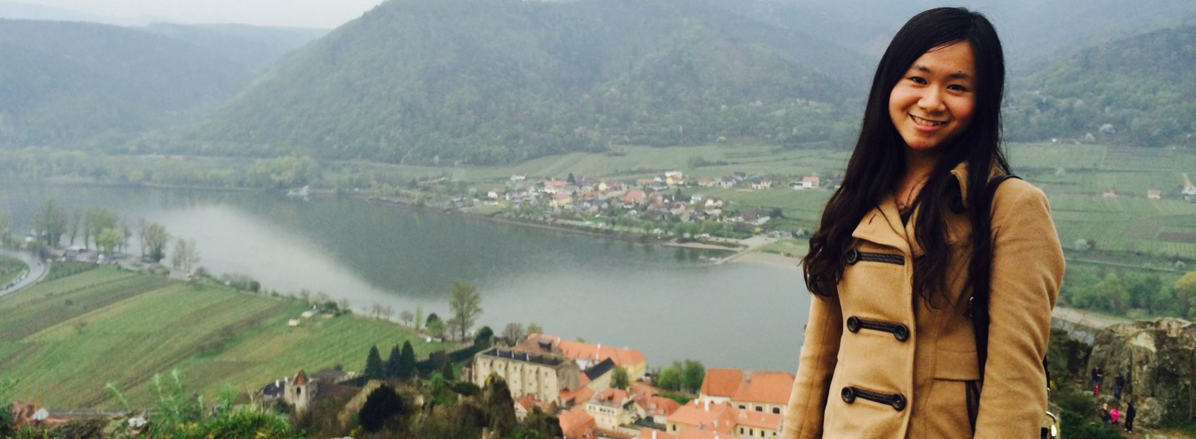 student in austria in front of mountain and lake landscape