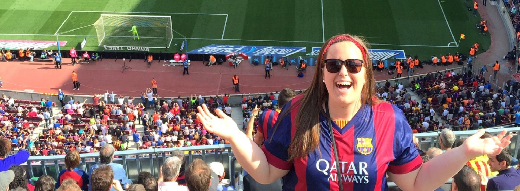 IES Abroad student smiling in front of soccer stadium