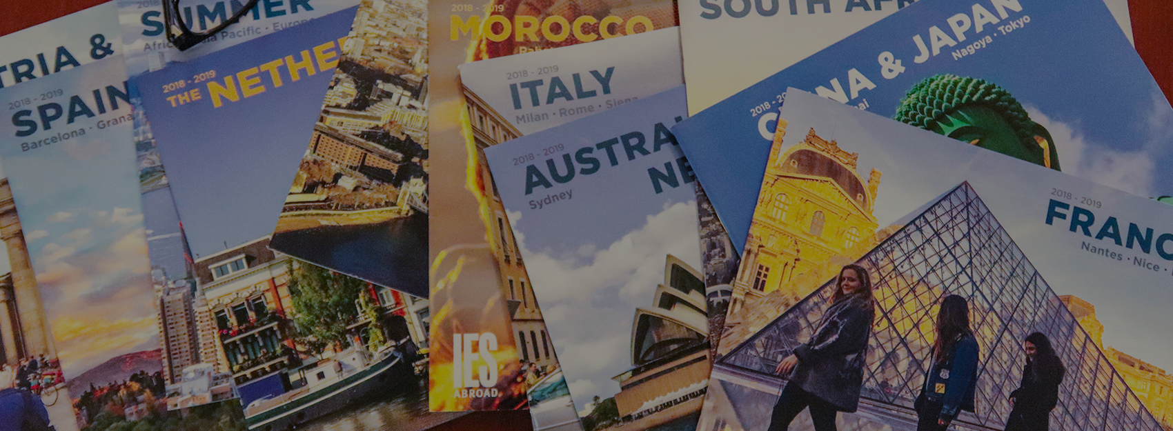 birds eye view of IES Abroad catalogs on a table