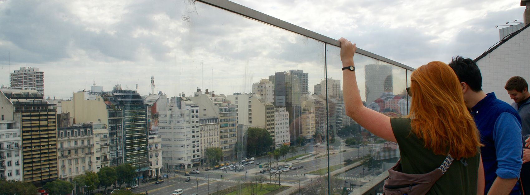 Buenos Aires study abroad students look out over the street behind glass