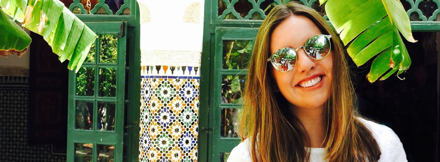 Rabat study abroad student in front green doors and mosaic art