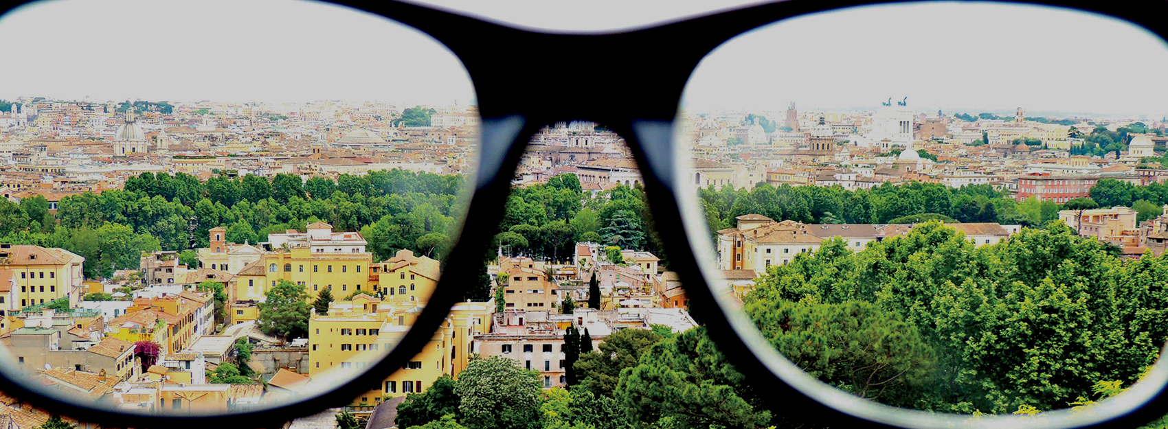 IES Abroad Rome student photo of the city from above looking through black glasses frames