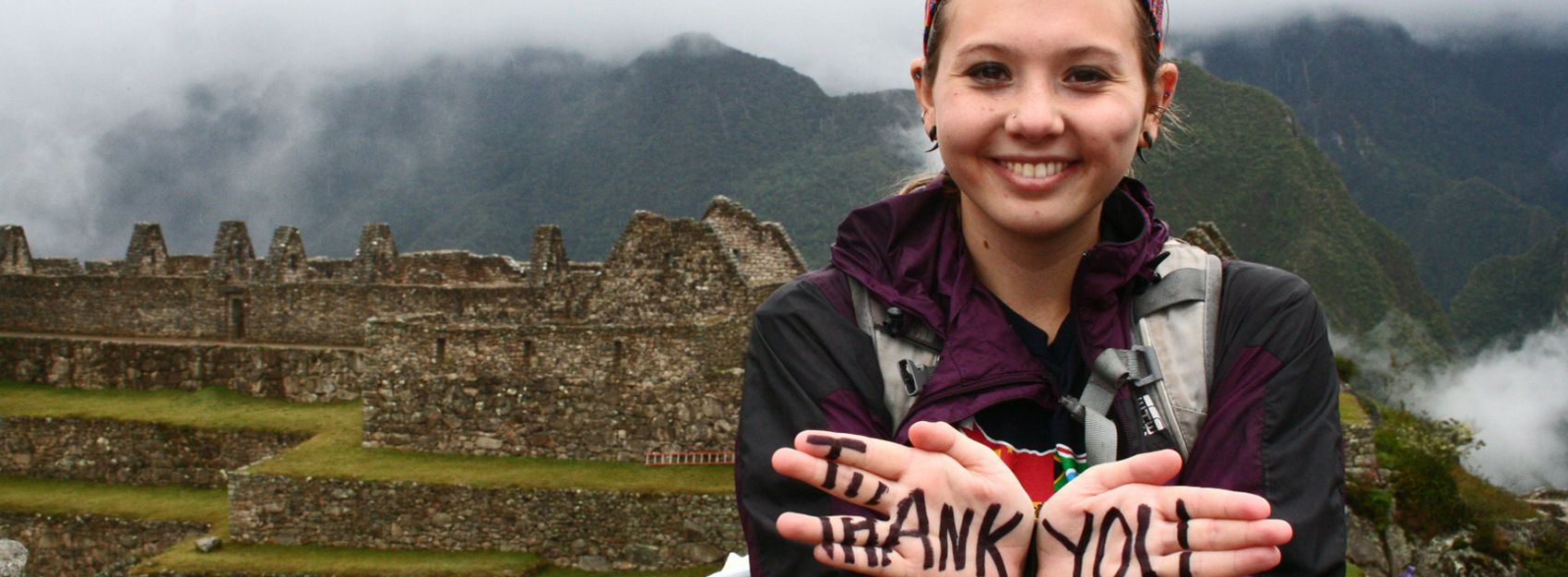 student hiking with thank you written on hands