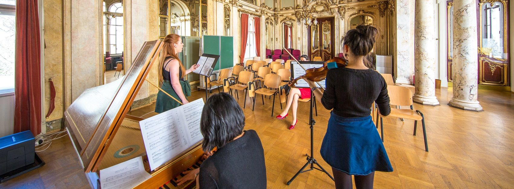 music students performing on piano, violin, and voice to instructor in Vienna
