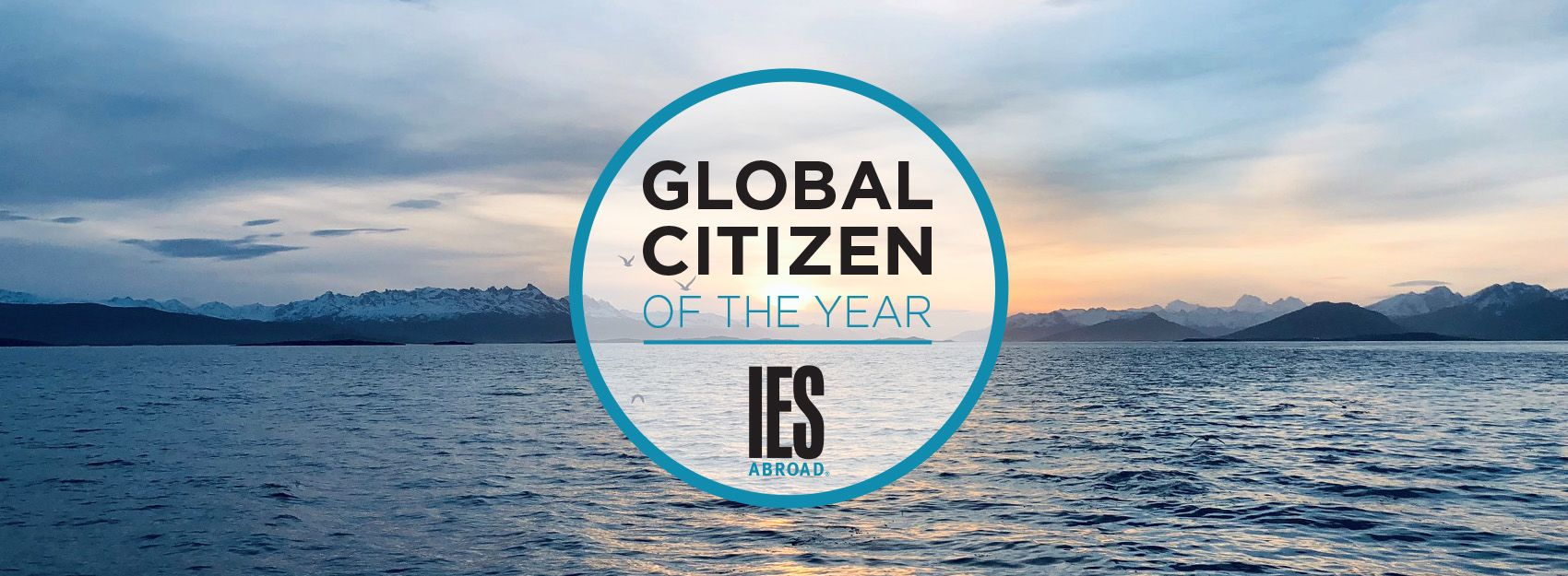 global citizen of the year logo on top of a scenic background with water