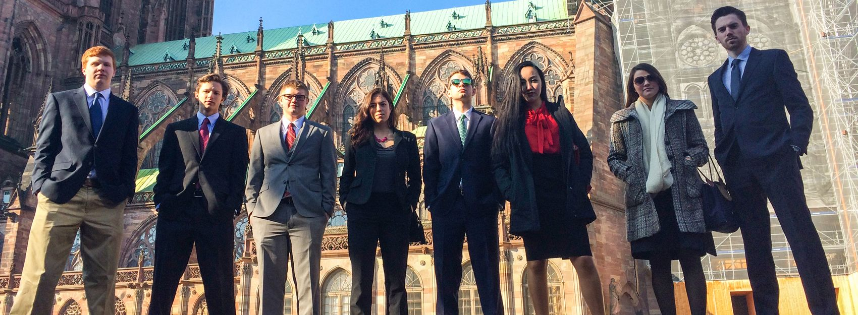 Group of Students in Suits on a Study Abroad Program