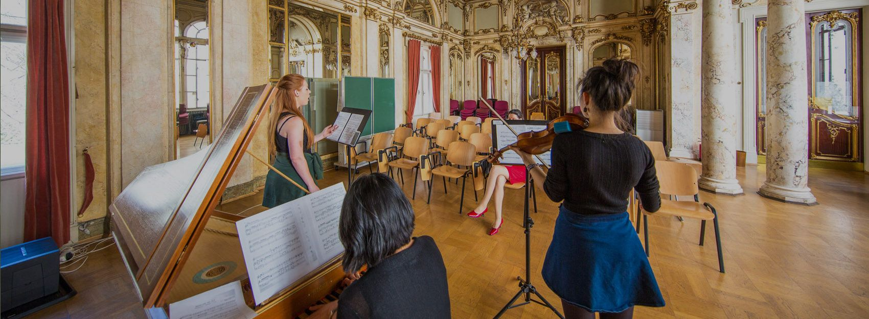 study abroad music students performing on piano, violin, and voice to instructor in Vienna