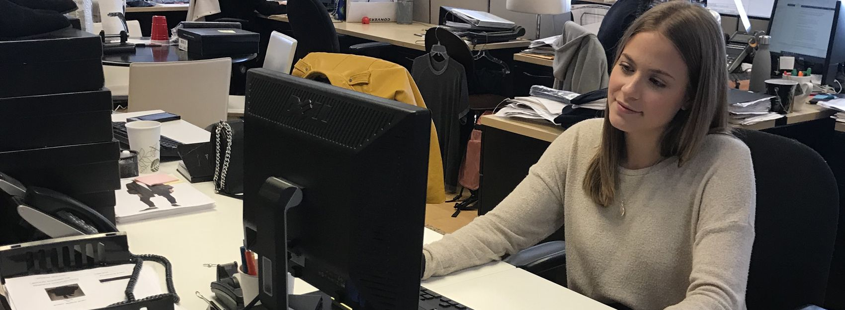 intern working at computer desk in an office