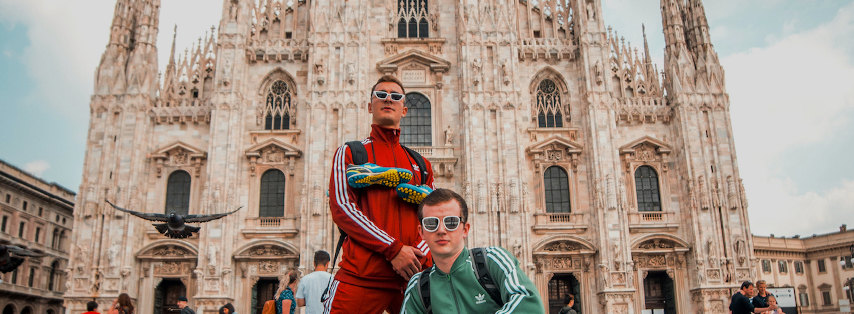 two students in front of the milan duomo