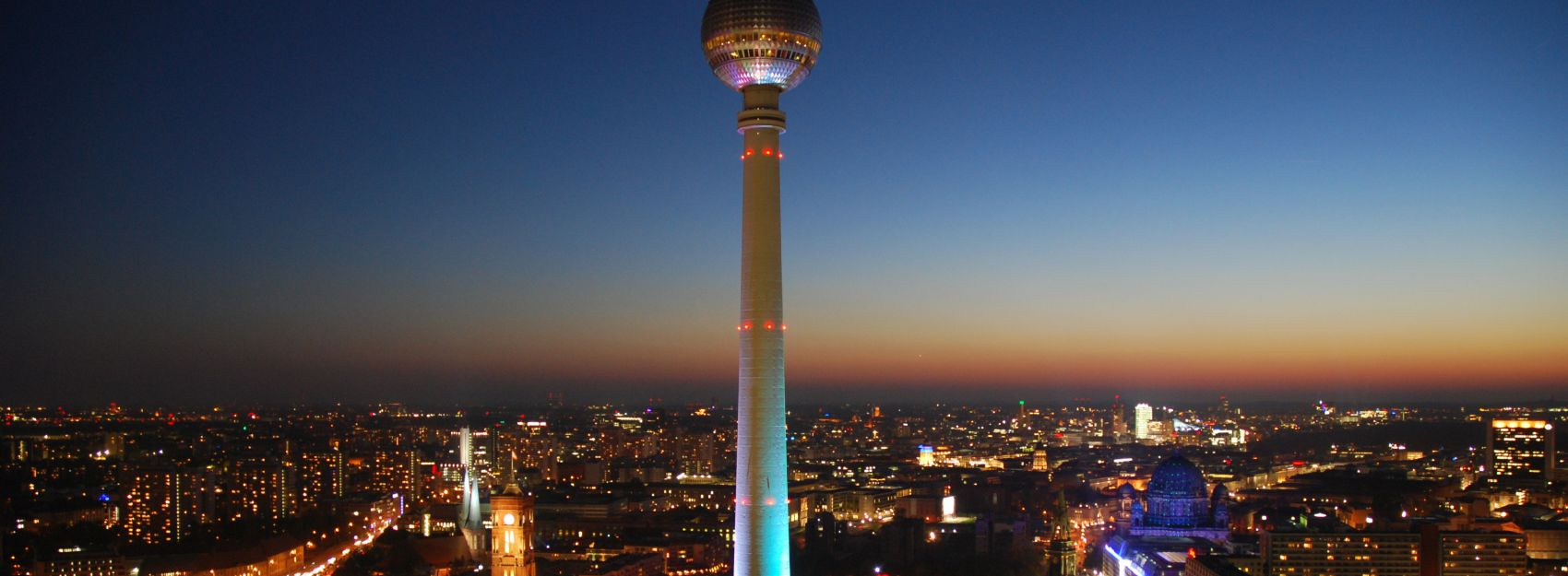 Berlin skyline at night, with the Berlin TV Tower at the center.