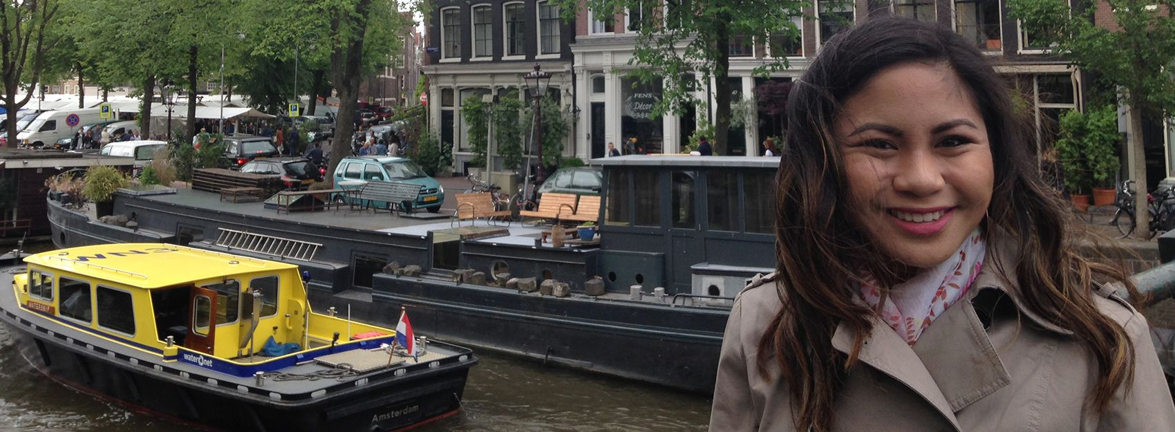 IES Abroad Amsterdam Business student at the canal