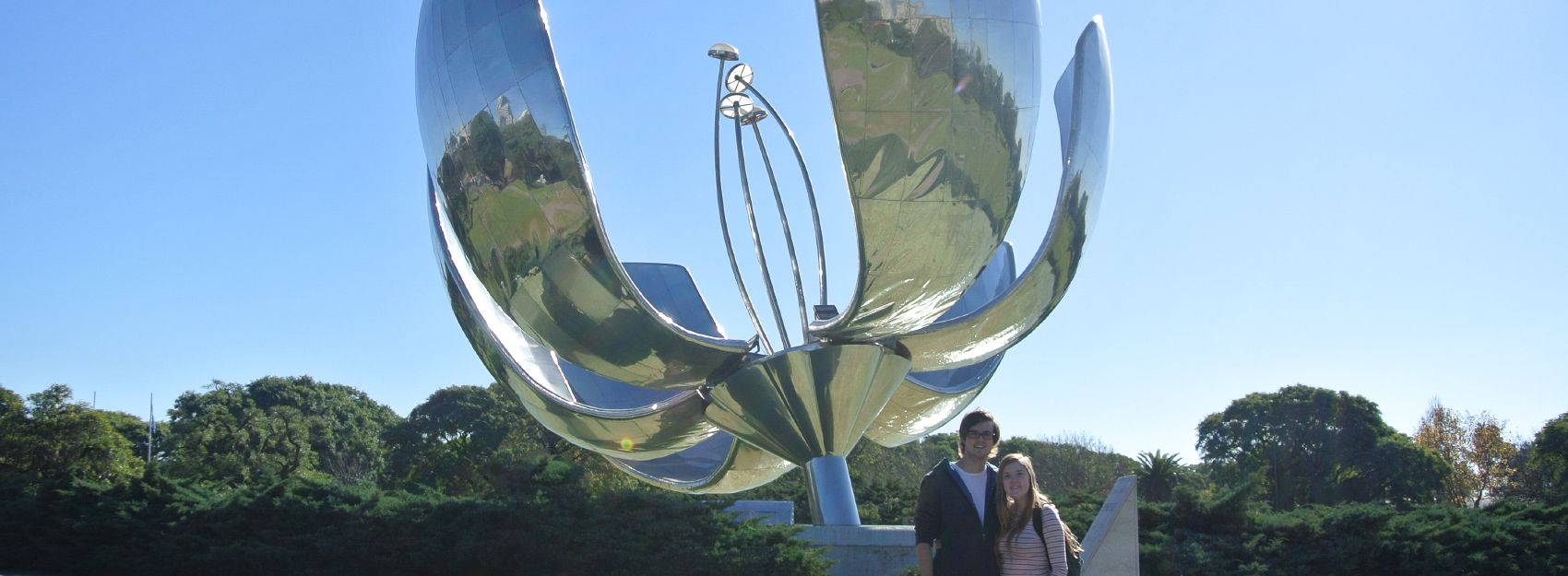 Two students in front of flower statue in Buenos Aires