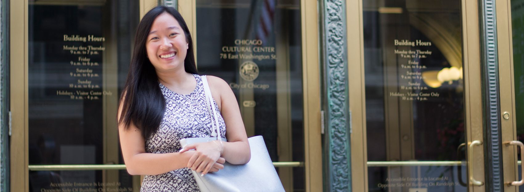 Summer intern in Chicago in front of Cultural Center