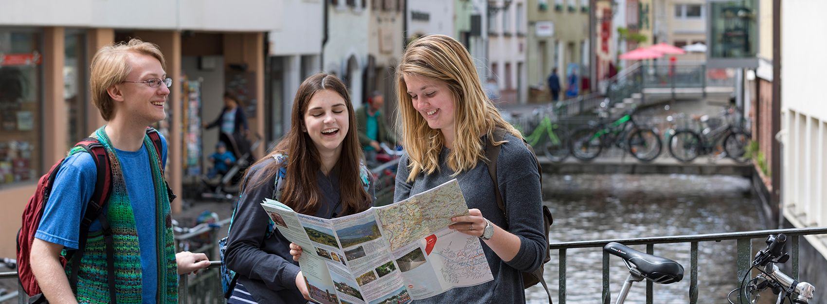 Freiburg study abroad students look at a map