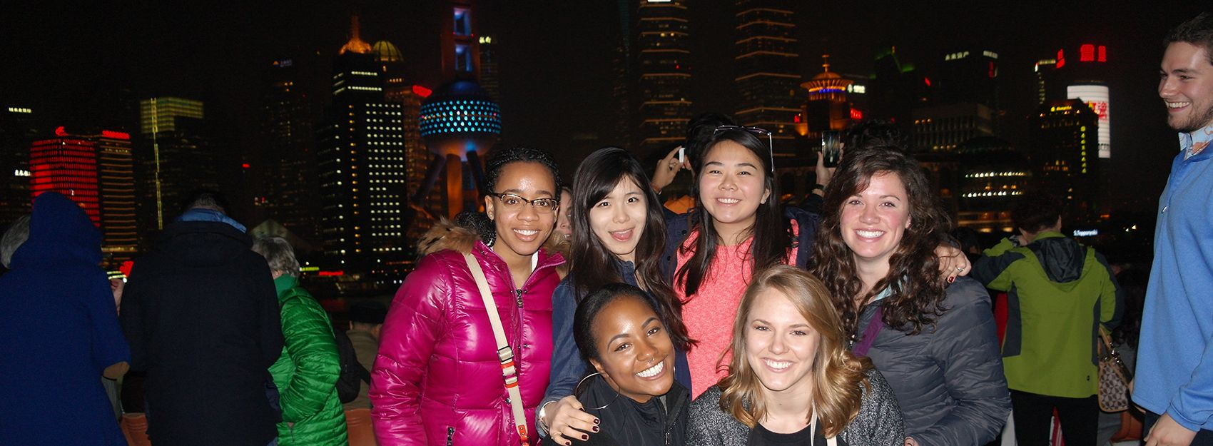 Students in front of Shanghai skyline