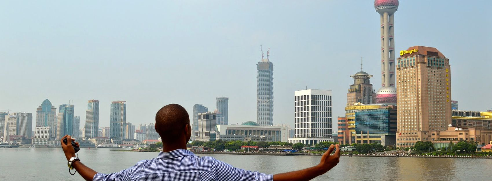Student in front of Shanghai skyline
