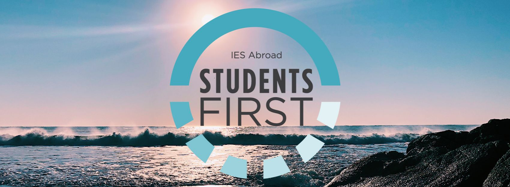 IES Abroad students first logo on sunset beach background