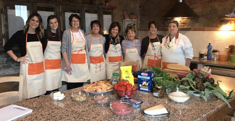 ambassador mariah bensley with her family at an Italian cooking class