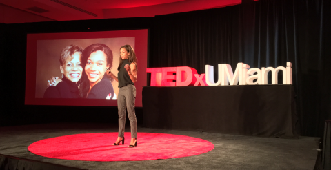 Breana Ross on stage giving her TEDx talk.