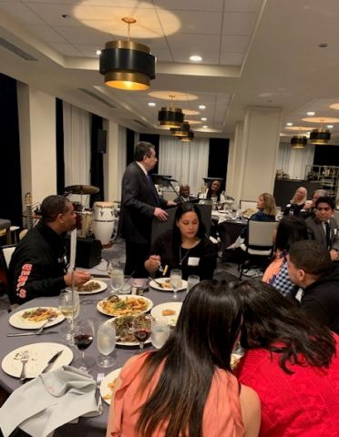 Dr. Flores speaking to dinner guests