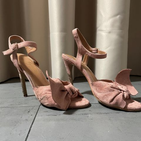 a pair of pink sandals