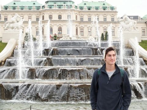 Will standing in front of a fountain in Vienna