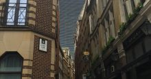 Old alleyways in the shadow of modern buildings