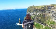 Staring dramatically out at the Cliffs of Moher.
