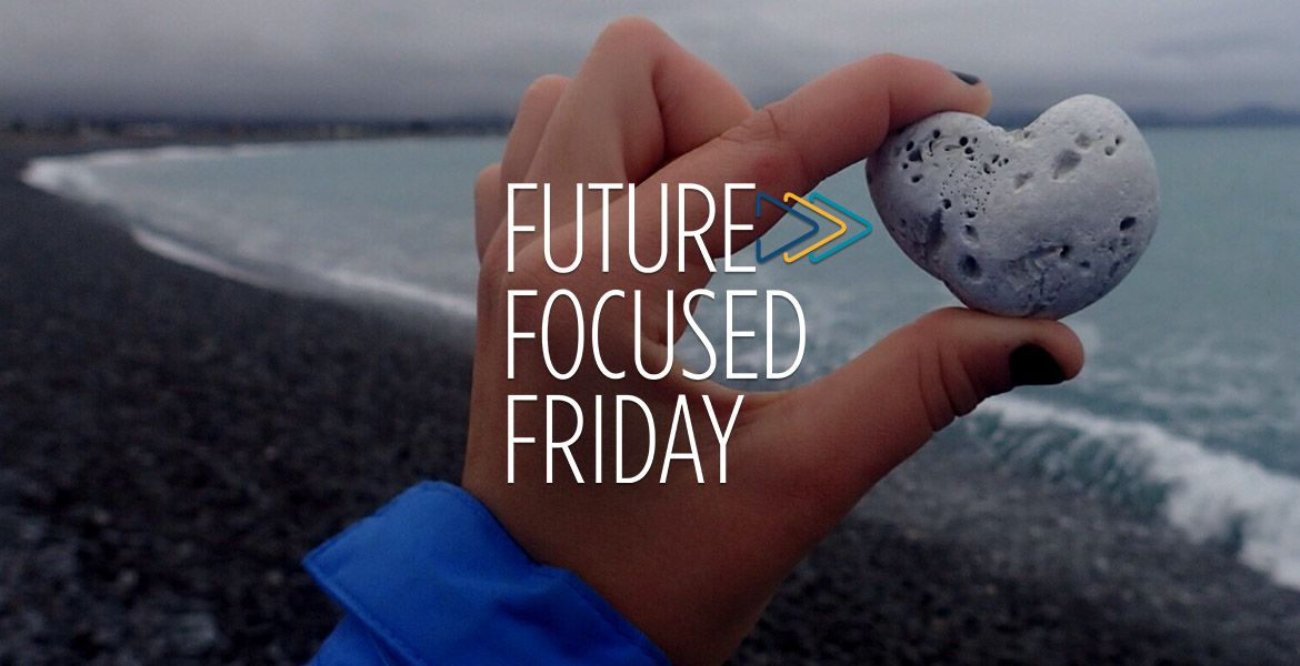 """Student holding a heart-shaped rock with the """"Future-Focused Friday"""" logo layered over the image"""