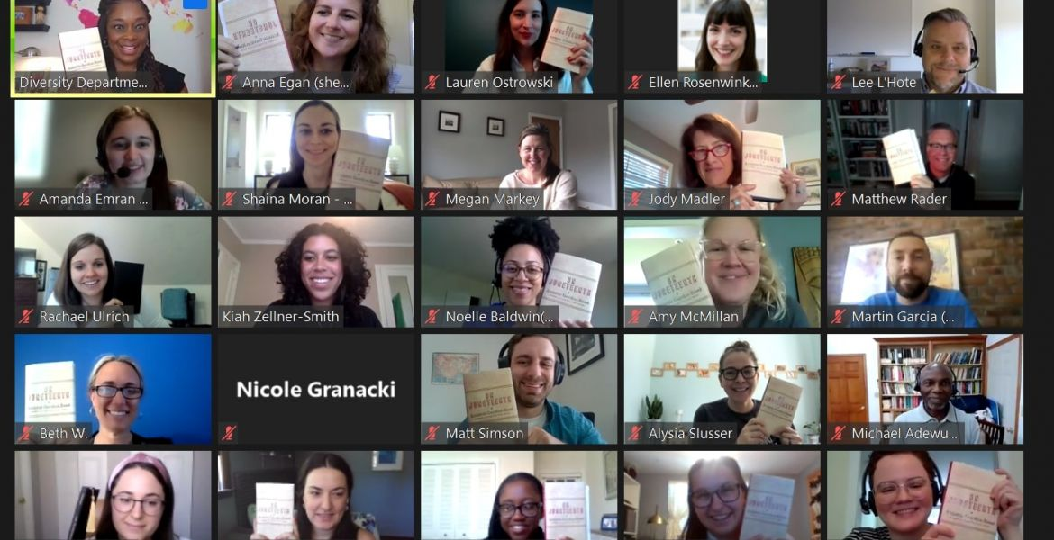 a screenshot of a Zoom meeting with people holding up a book