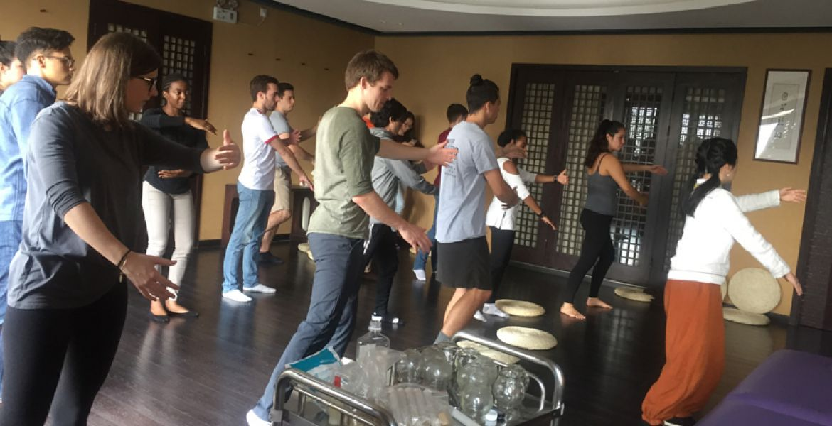 IES Abroad Shanghai students learning tai chi from a master