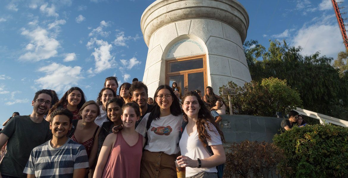 students at the top of cerro san cristobal in chile