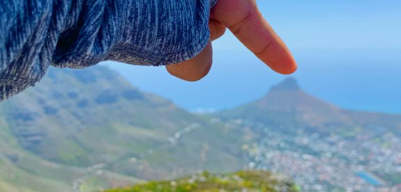 View of Lion's Head mountain with a hand pointing to it