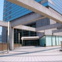 Outside the building that houses the IES Abroad Tokyo Center. Contemporary building with large windows and outdoor space.