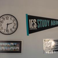 wall decor including clock and IES Abroad pennant