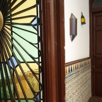 stained glass window and tile walls in center