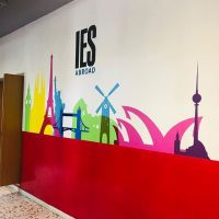 colorful mural of world monuments on wall with IES Abroad logo