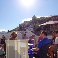 class meeting on the roofdeck terrace with alhambra in background