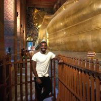 Jonathan Thibeaux in front of Reclining Buddha