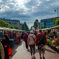 Shoppers Walk Through Albert Cuypmarkt on a Chilly Morning