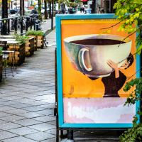 A Poster Outside a Cafe in the Oost